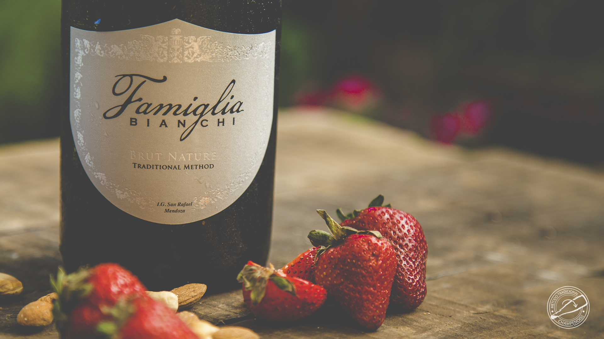 Famiglia Brut Nature bottle with strawberries